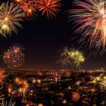 City celebrating 4th of July with fireworks